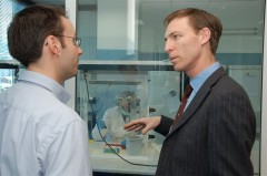 Rene Huel, Head of ICMP DNA Laboratories explains the DNA identification proces to the United Kingdom Minister for Europe, Mr. Jim Murphy