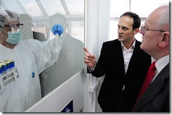 ICMP's Edin Jasaragic explains to Mr Manaj the process of DNA profile extraction in the ICMP Identification Coordination Division, in Tuzla, Bosnia and Herezgovina.