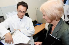 Baroness Kinnock briefed by the head of ICMP DNA Laboratories Division Rene Huel on the work of ICMP laboratory system.