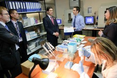 British Foreign Minister David Miliband briefed about the work in ICMP labs by ICMP's Rene Huel.