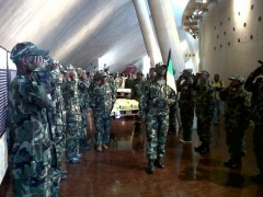 Coffins being carried out with guard of honour