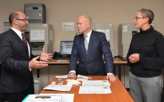 Adam Boys, ICMP's Chief Operating Officer, briefs UK Foreign Secretary William Hague in ICMP's main laboratory