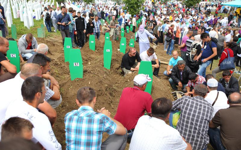 Family members gathered at Srebrenica memorial cemetery