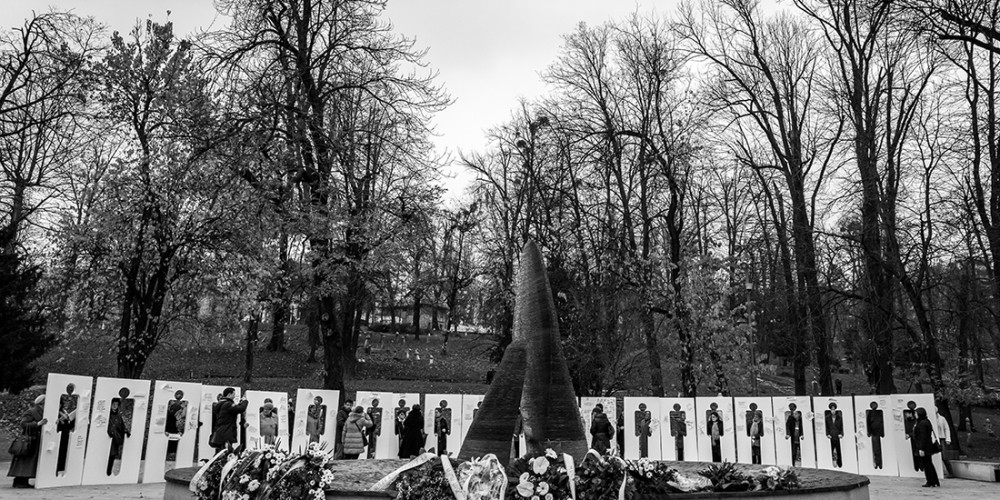 Members of the Forum on Joint Memorialization of Missing Persons hold silhouettes of missing persons  Photo: Velija Hasanbegovic, Radio Sarajevo