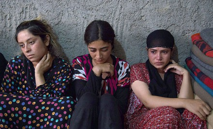 Mass graves of Yazidi women have been found in Sinjar Photo: Rex
