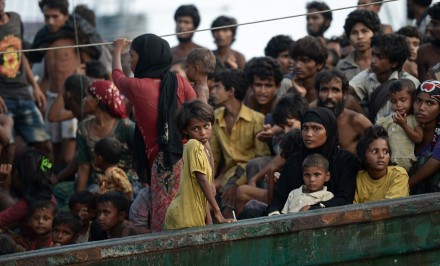 Rohingya migrants stand and sit on a boat drifting in Thai waters off the southern island of Koh Lipe in the Andaman sea on May 14, 2015.. Photo by: AFP/Christophe Archambault