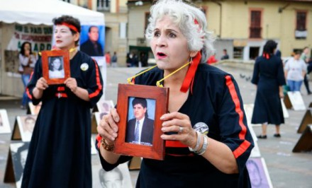 Mothers at Bolivar Square in Bogota, Colombia, holding photos of their children, who are victims of enforced disappearance.©iStockphoto.com/jcarillet